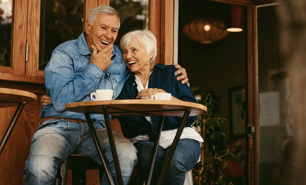 Laughing Older Couple at Outdoor Cafe