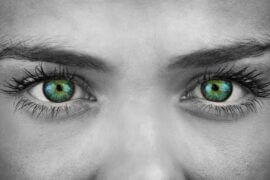 Black and white photo of woman with green eyes