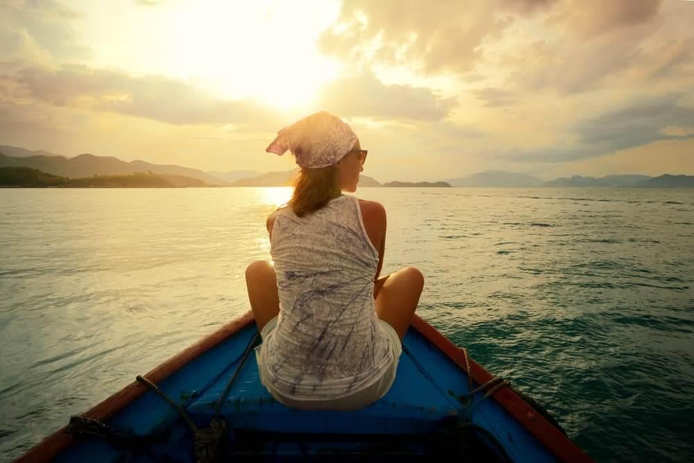 Woman in kyack on lake